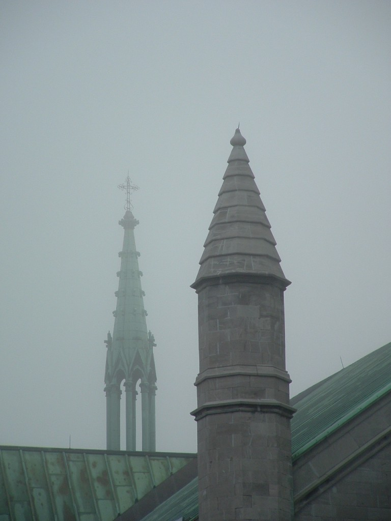 Church towers and roof in fog