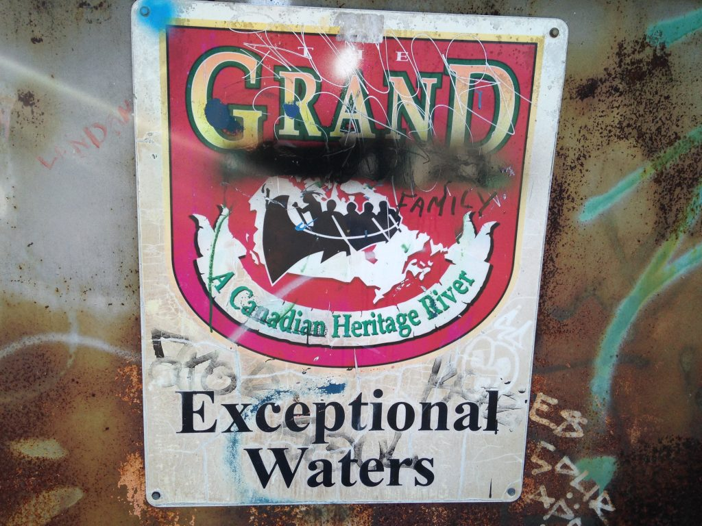 Worn metal signage for the Grand River ON