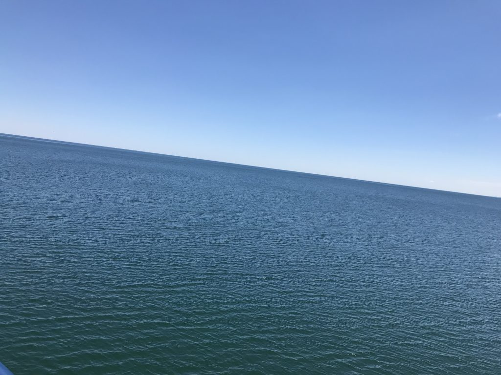 looing out at the horizon on the lake